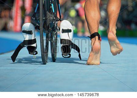 Triathlon bike the transition zone detail of the legs