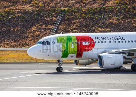 Funchal, Madeira - July 6, 2016: Tap Portugal Airbus A319-111 Lands At Funchal Cristiano Ronaldo Air