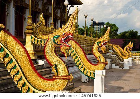 NAGA inThailand Bhudda temple golden Stupa Khonkaen landmarkTemple against blue sky in Khon Kaen Thailand; Wat Nong Waeng (Temple)