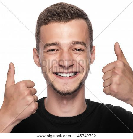 Happy man showing a thumbs up in approval.