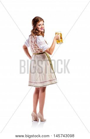 Beautiful young woman in traditional bavarian dress holding a mug of beer. Oktoberfest. Studio shot on white background, isolated. Rear view