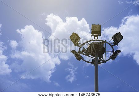 Close up of Spot lights tower on blue sky and clouds with copy space natural color picture style image,selective focus,light effect added