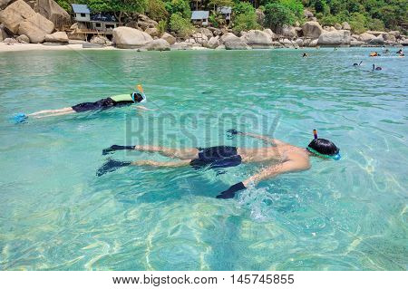 Snorkeling on an island beach with cristal clear water