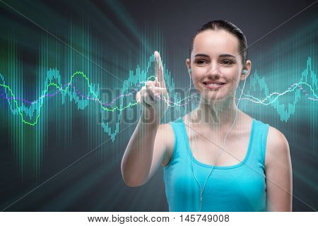Woman in sports concept monitoring heart rate