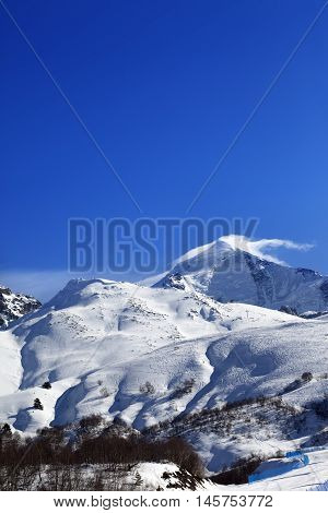 Mount Tetnuldi And Off-piste Slope With Track From Ski And Snowboard In Sun Day