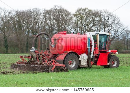 Injection of liquid manure with arable manure spreader in the Netherlands.