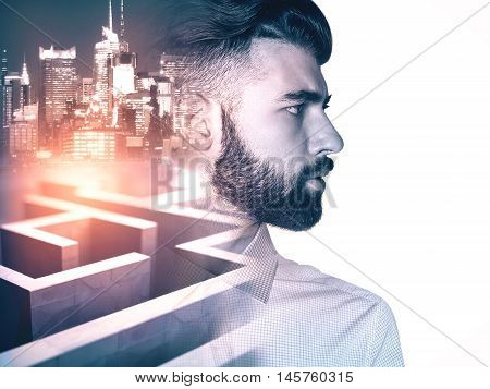 Side view of young businessman on side turned city and maze background with abstract sunlight. Business obstacle concept. Double exposure