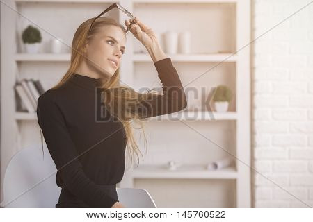 Woman Daydreaming At Workplace