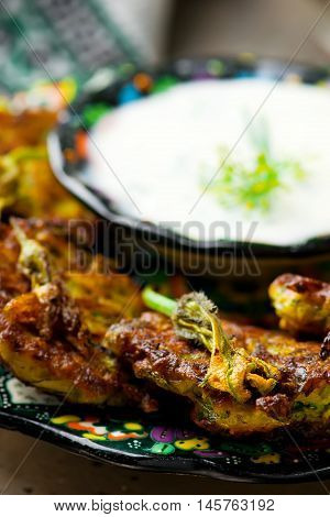 vegetable marrows fritters with johurt. selective focus