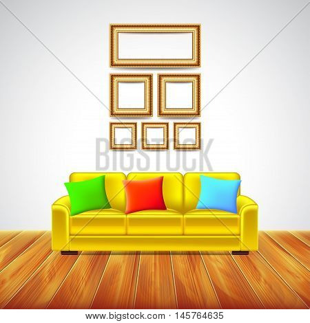 Interior room with yellow sofa colorful pillows picture frames and wooden floor