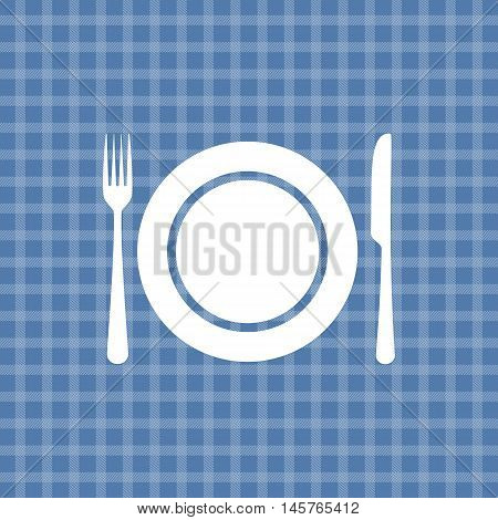 Plate knife and fork on blue picnic checkered tablecloth