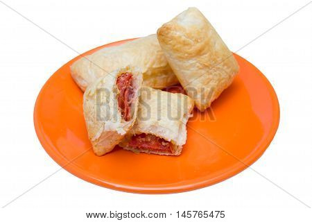 Puff pastry appetizers with salami and cheese on a white background