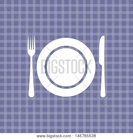 Plate knife and fork on violet picnic checkered tablecloth