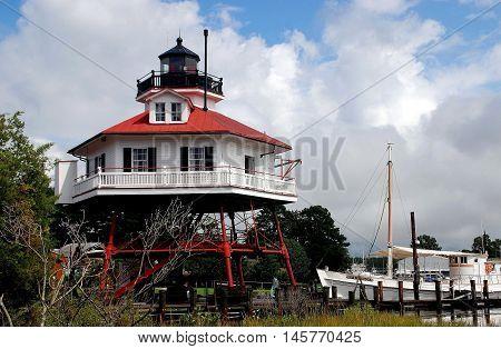 Solomon's Island Maryland - September 9 2011: Hexagonal 1883 Drum Point Lighthouse at the open-air Calvert Marine Museum