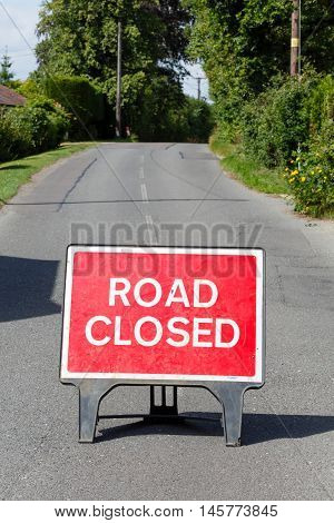 Road sign on a street showing a road closure