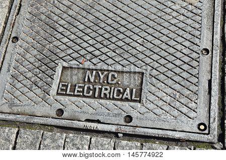 NEW YORK - DECEMBER 28, 2015: Manhole cover for electrical inspection. Manhattan, New York, USA.