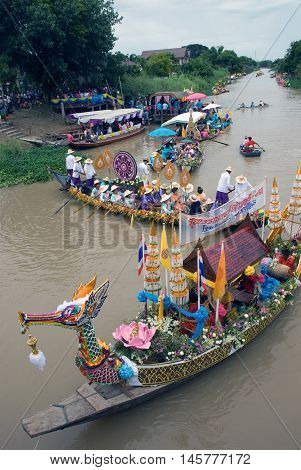 AYUTTHAYA, THAILAND - JULY 15, 2011: Festival Buddhist Lent Day merit parade at Lad Chado canal traditional parade in Lad Chado candle floating festival to temple at Amphoe Pak Hai , Ayutthaya Province , Middle of Thailand.