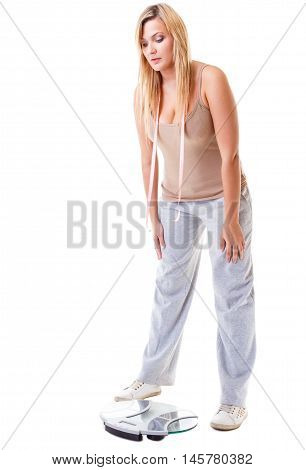 Health care overweight problem. Woman plus size large girl with scale unhappy worried looking depressed with her weight control isolated on white