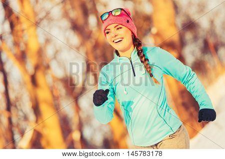 Girl Exercising In Winter Clothing