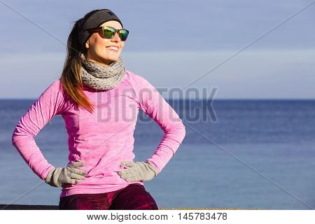 Woman Resting After Doing Sports Outdoors On Cold Day