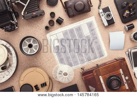 Negatives scaning. Black and white photography. Traditional photography. View from above. Scanning proces.