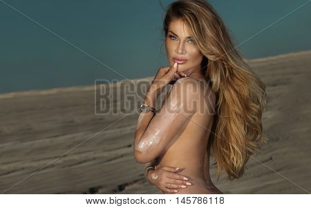 Sexy Naked Woman On Desert.