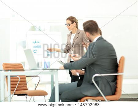 Successful businesswoman in suit at the office leading a group