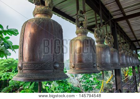 Bell hanging on a steel beam black.