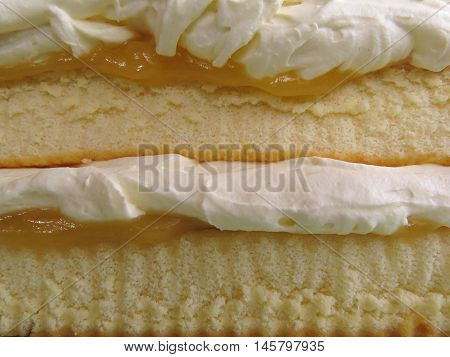 Sponge cake layers with cream and lemon curd
