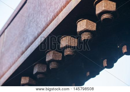 Rusty bolts and nuts of metal construction elements
