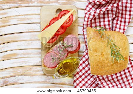 traditional Italian ciabatta bread with cheese, sausage, tomatoes and olive oil