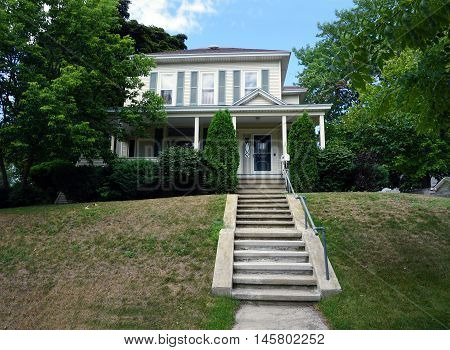 PETOSKEY, MICHIGAN / UNITED STATES - AUGUST 5, 2016: A Victorian home with a wraparound porch on Mitchell Street near downtown Petoskey.