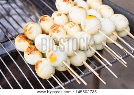 Close up Thai street food Grilled chicken eggs.