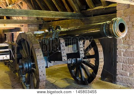 An old artillery powder cannon in a castle