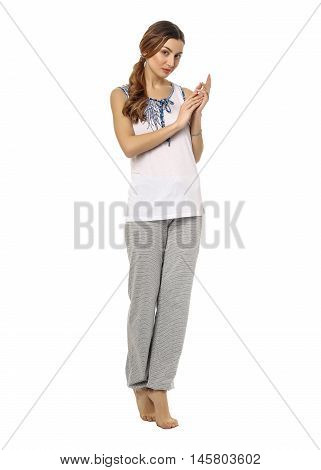 Young Woman In Pajamas Isolated On White Background