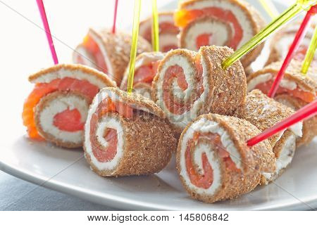 Tiny salmon canape with bread and cream cheese