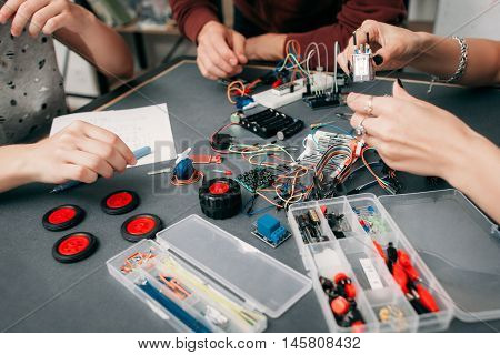 Construction of electronic car with microcontroller. Collective creation of diy electronics, modern technologies, innovation and science concept