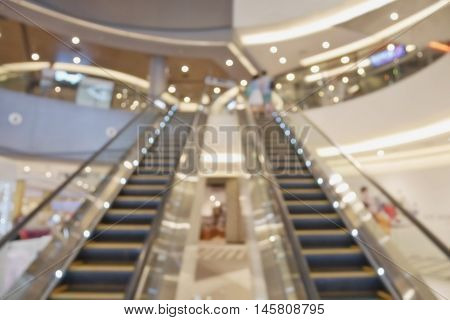 Blurred image of empty escalator in shopping mall