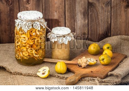 Quince preserves in a wooden pantry. Jam and  fruit liquor in jar