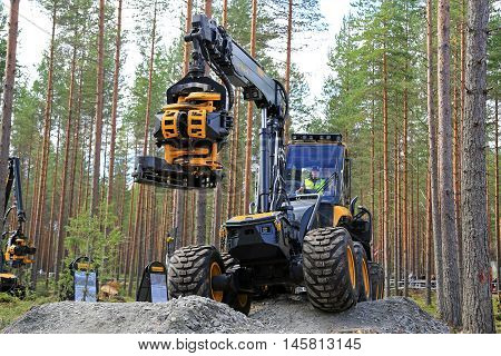 JAMSA FINLAND - SEPTEMBER 2 2016: Ponsse forest harvester Ergo and harvester head presented during a ride over rough terrain a work demonstration by Ponsse on the heavy machinery exhibition FinnMETKO 2016 in Jamsa Finland.