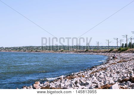 Fisherman On The Beach In The Summer Of Granite