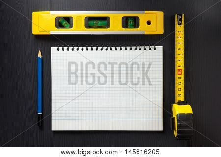 notebook and pencil on wooden texture