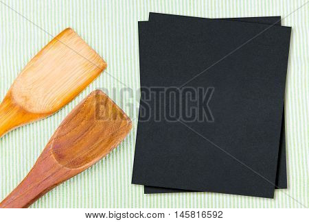 Wood Spoon On Green Table Cloth With Blank Black Menu Paper, Mock Up For Adding Your Design