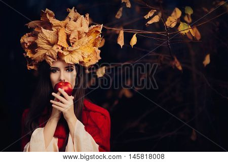 Woman With Autumn Leaves Crown Eating an Apple