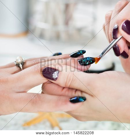 Fingernail design in nail salon, toned image