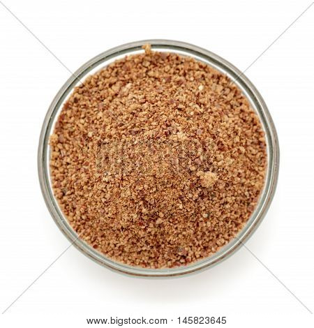 Organic powder of Indian Jujube (Ziziphus mauritiana) in a glass bowl. Isolated on white background. Top view.