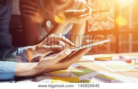 Coworkers Making Great Decisions.Young Business Marketing Team Discussion Corporate Work Concept Modern Office.New Startup Creative Idea Presentation.Woman Touching Smartphone Screen.Flare.Closeup