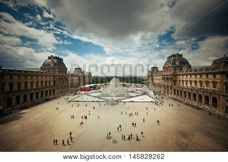 PARIS, FRANCE - MAY 13: Louvre closeup exterior view on May 13, 2015 in Paris. With over 60k sqM of exhibition space, Louvre is the biggest Museum in Paris.