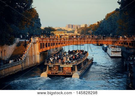 PARIS, FRANCE - MAY 13: Historical architecture and River Seine at sunset on May 13, 2015 in Paris. With the population of 2M, Paris is the capital and most-populous city of France