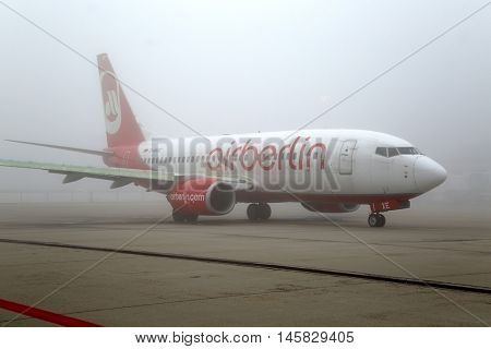 BUDAPEST, HUNGARY - DECEMBER 2, 2015: Air Berlin Boeing 737 taxiing at Budapest Liszt Ferenc Airport. Foggy weather with low visibility.